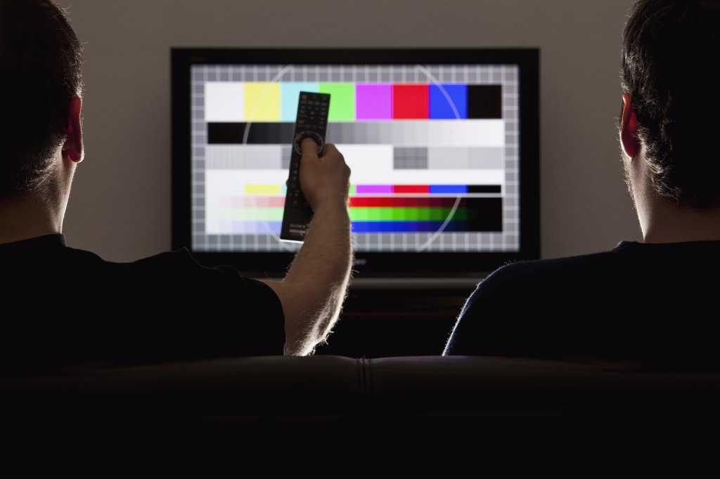 Two men watching a test pattern on a television : Stock Photo