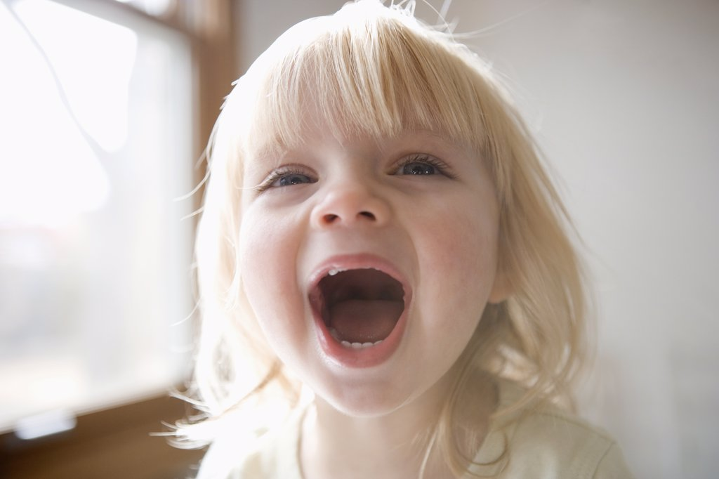 Portrait of a young girl laughing : Stock Photo
