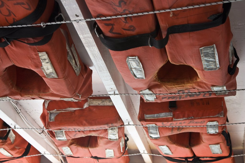 Stock Photo: 1570R-133806 Detail of life vests stowed on a ship