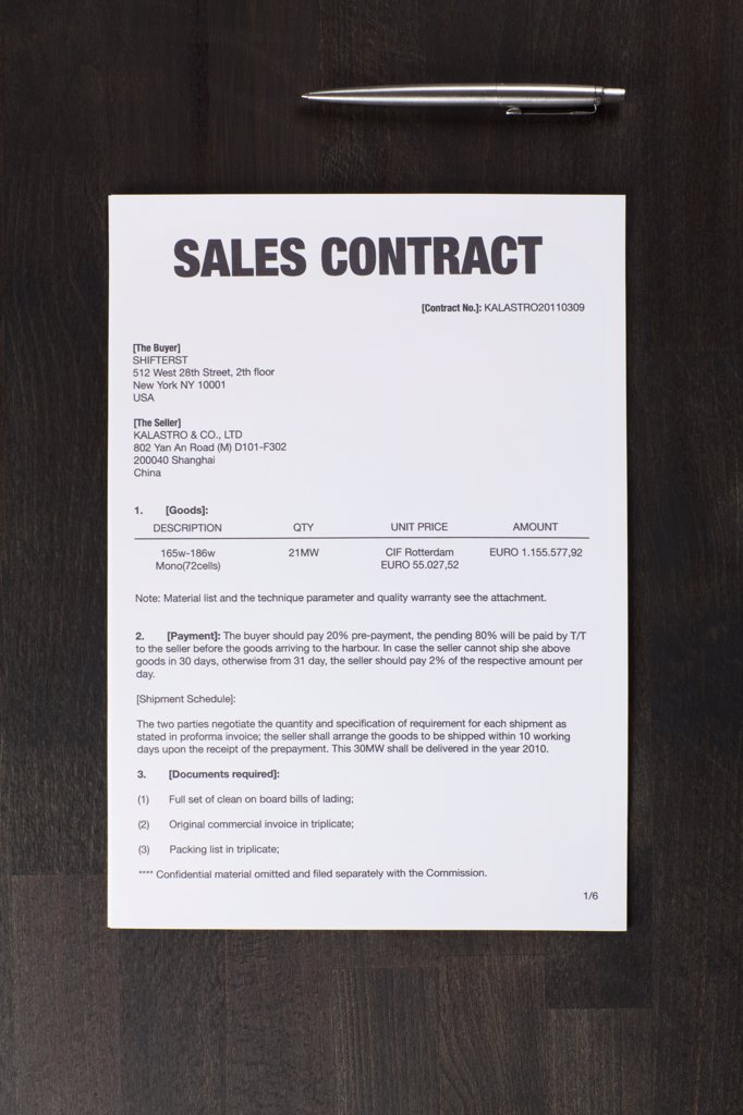 Stock Photo: 1570R-133852 A sales contract and a pen