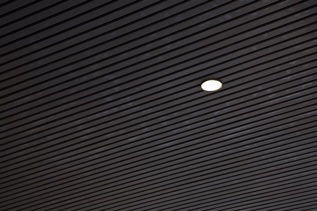 A light fixture in a ceiling : Stock Photo