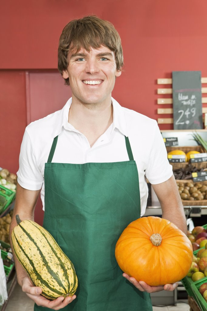 Stock Photo: 1570R-135211 A stocker holding two varieties of winter squash