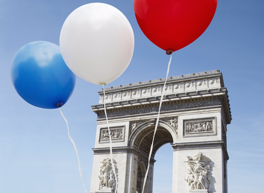 Balloons in the colors of the French flag in front of the Arc De Triomphe : Stock Photo