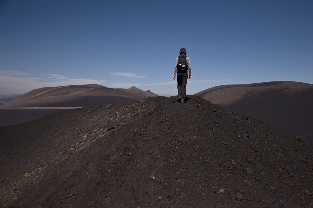 Stock Photo: 1570R-135340 Rear view of a woman hiking over Lonquimay Volcano, Chile