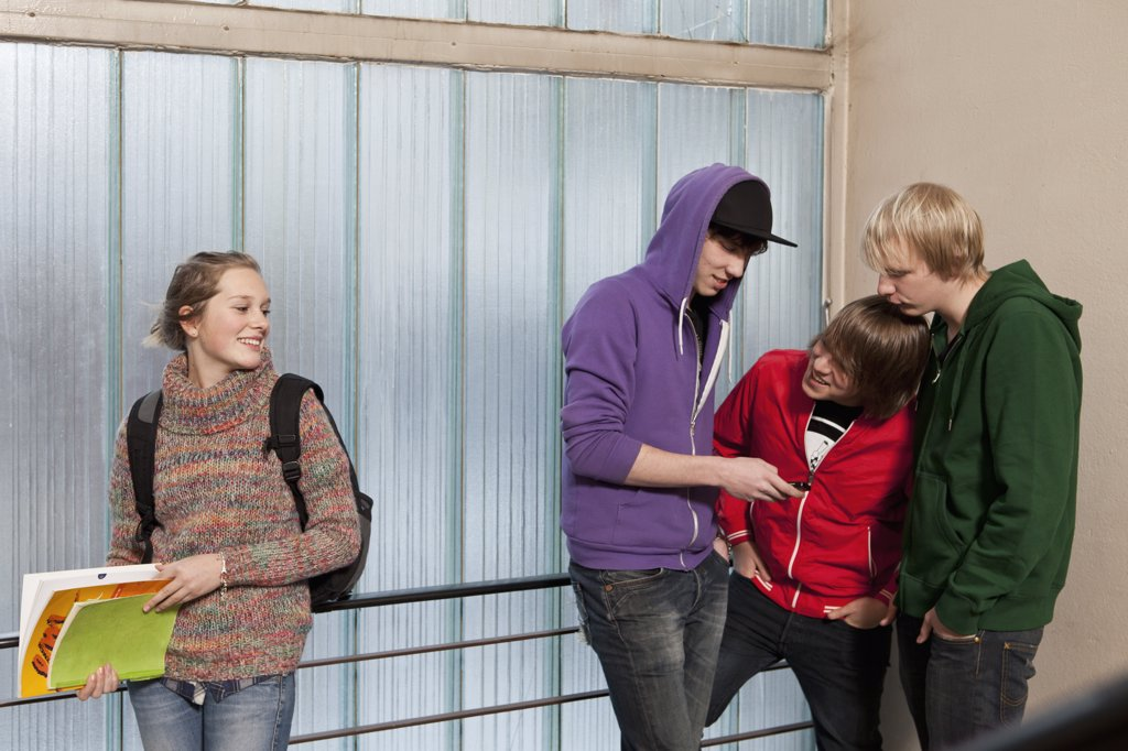 Stock Photo: 1570R-135696 Teenagers hanging out in a school stairwell