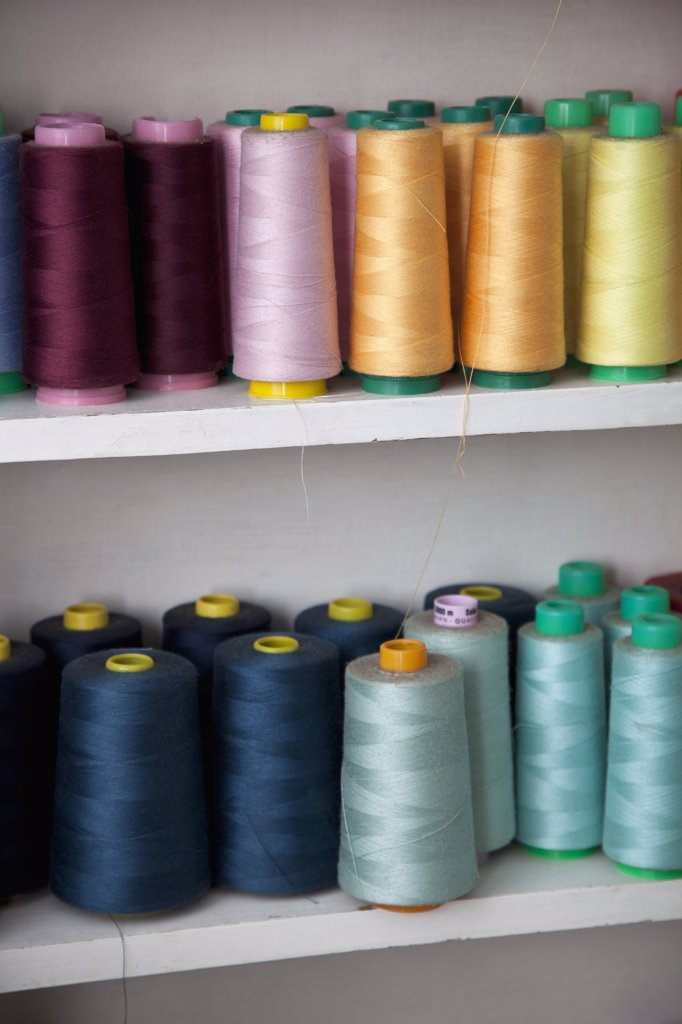 Stock Photo: 1570R-135868 Spools of colored cotton thread on shelves