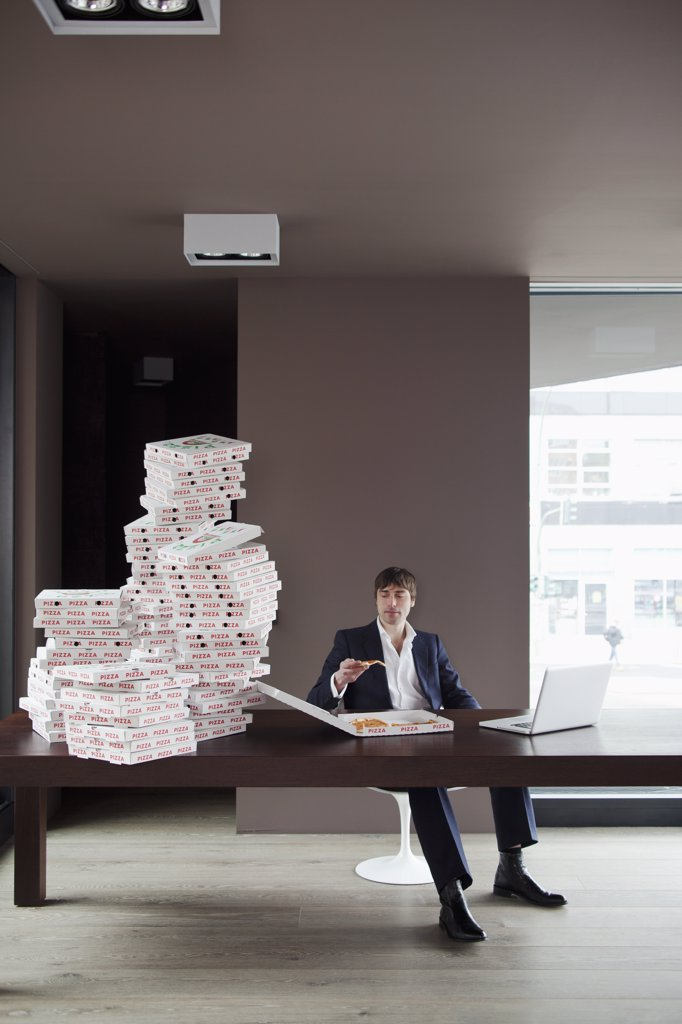 Many pizzas for businessman at home. : Stock Photo