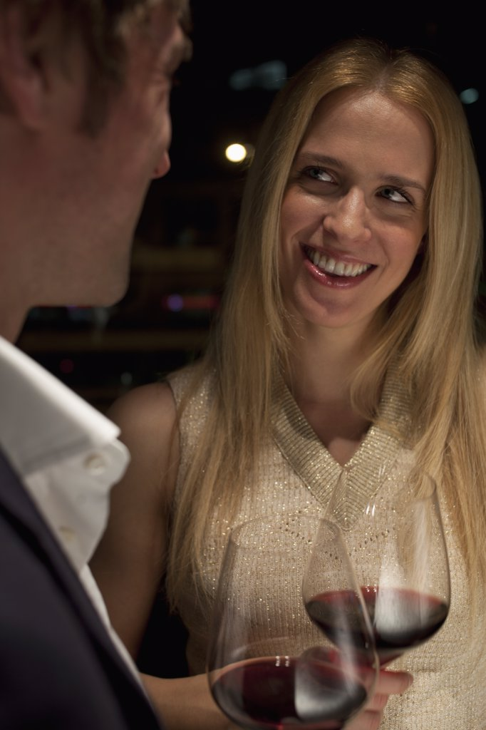 Stock Photo: 1570R-136059 Woman smiles admiringly as a toast is made.