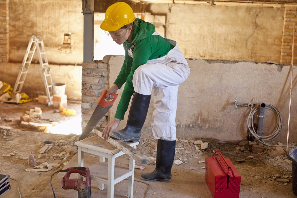 Stock Photo: 1570R-136553 A carpenter working on a construction site