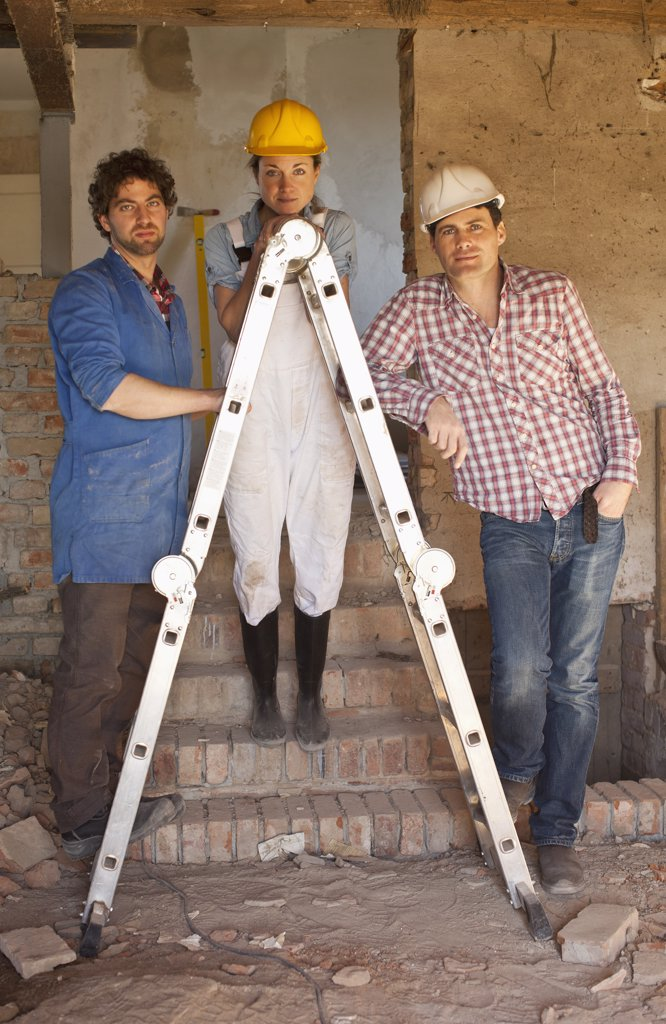 Stock Photo: 1570R-136563 Construction workers leaning on a ladder at a building site