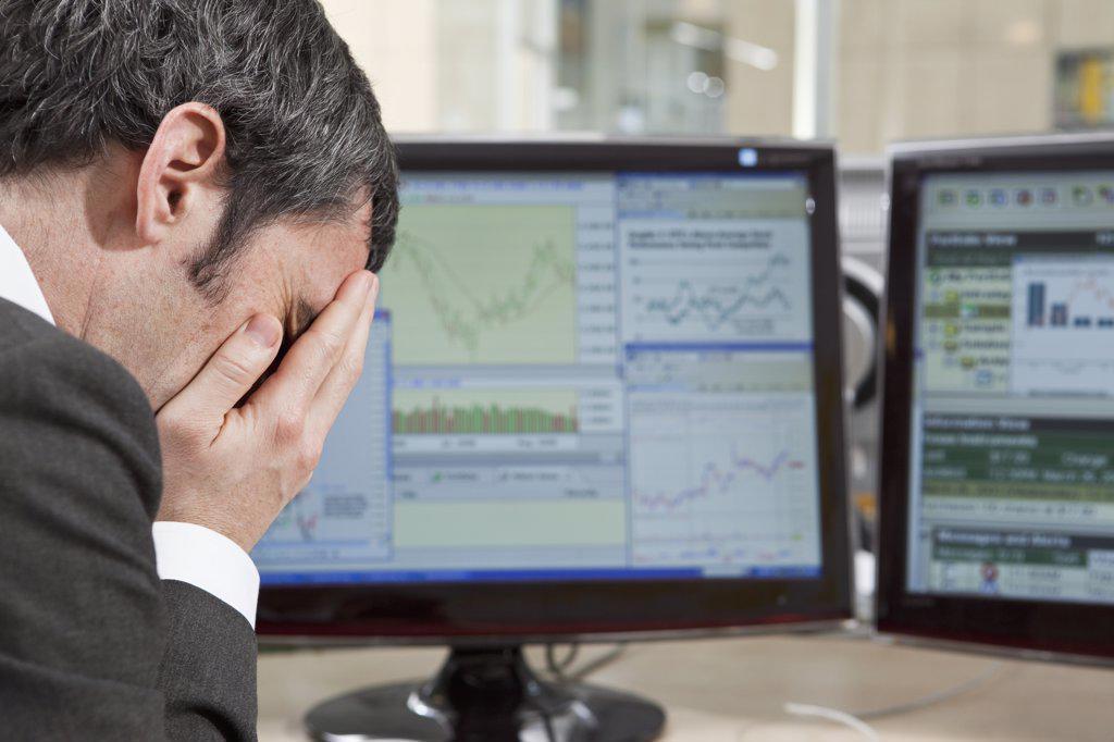 Stock Photo: 1570R-136939 Businessman feels the finance pressure