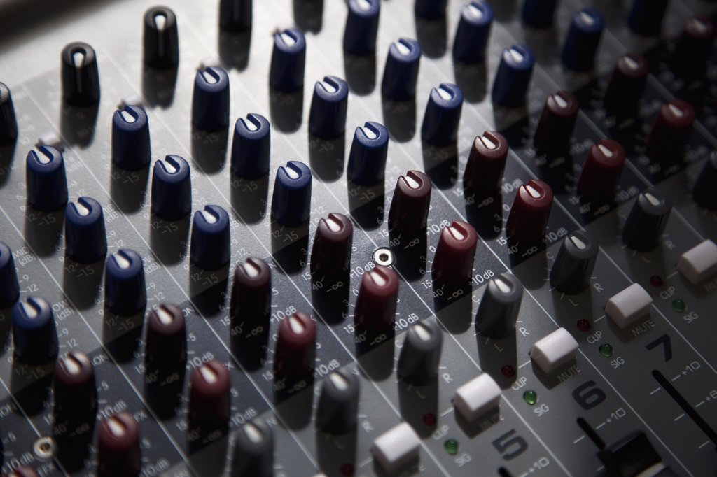 Stock Photo: 1570R-137465 A sound mixing board, close-up, full frame