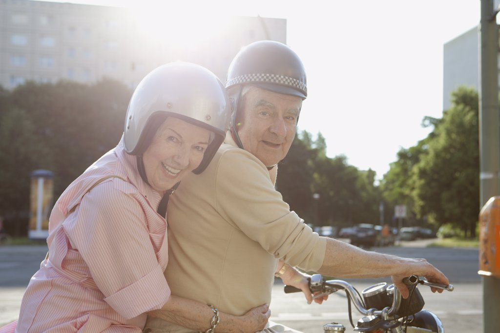 Stock Photo: 1570R-137502 Senior couple happy on motorbike