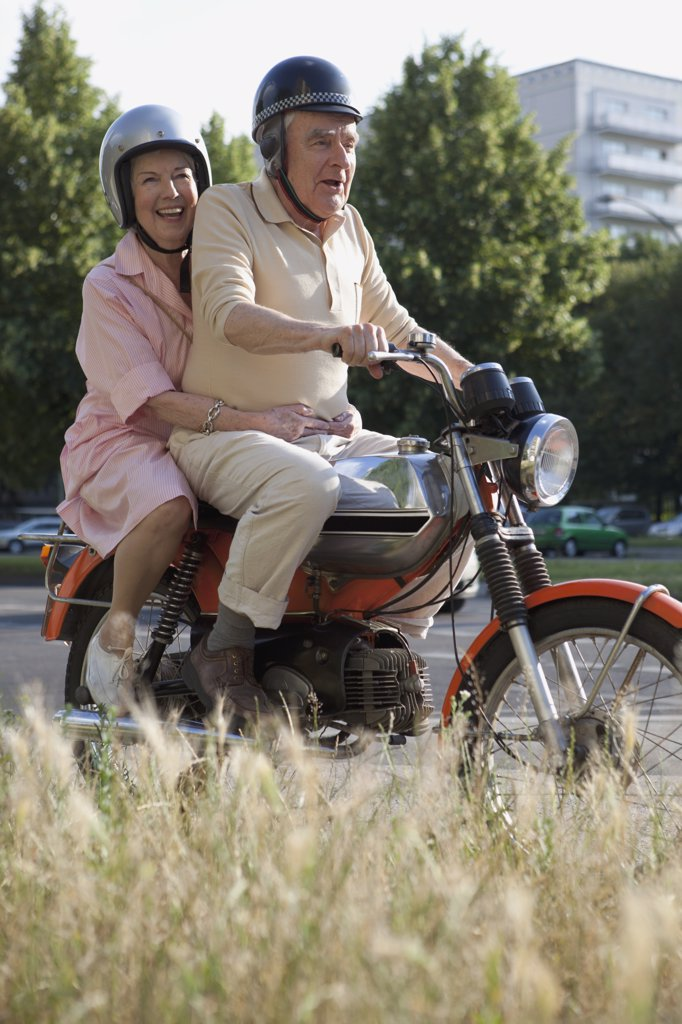 Senior couple happy on motorbike : Stock Photo