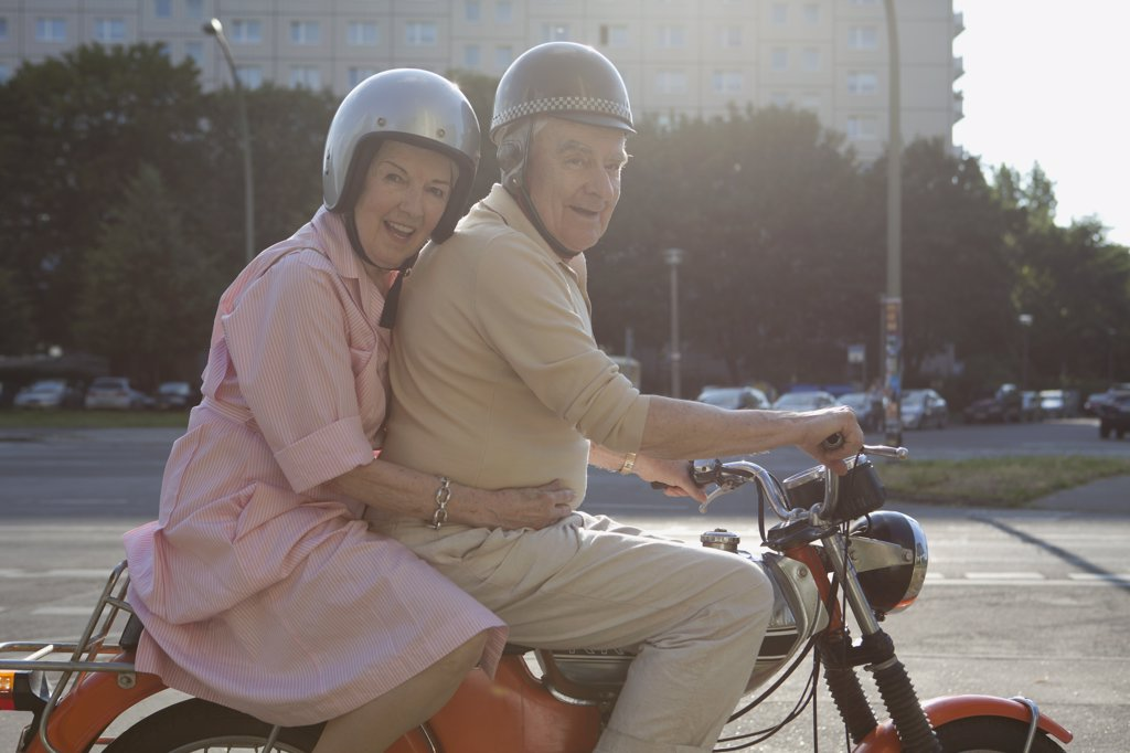 Stock Photo: 1570R-137527 Senior couple happy on motorbike