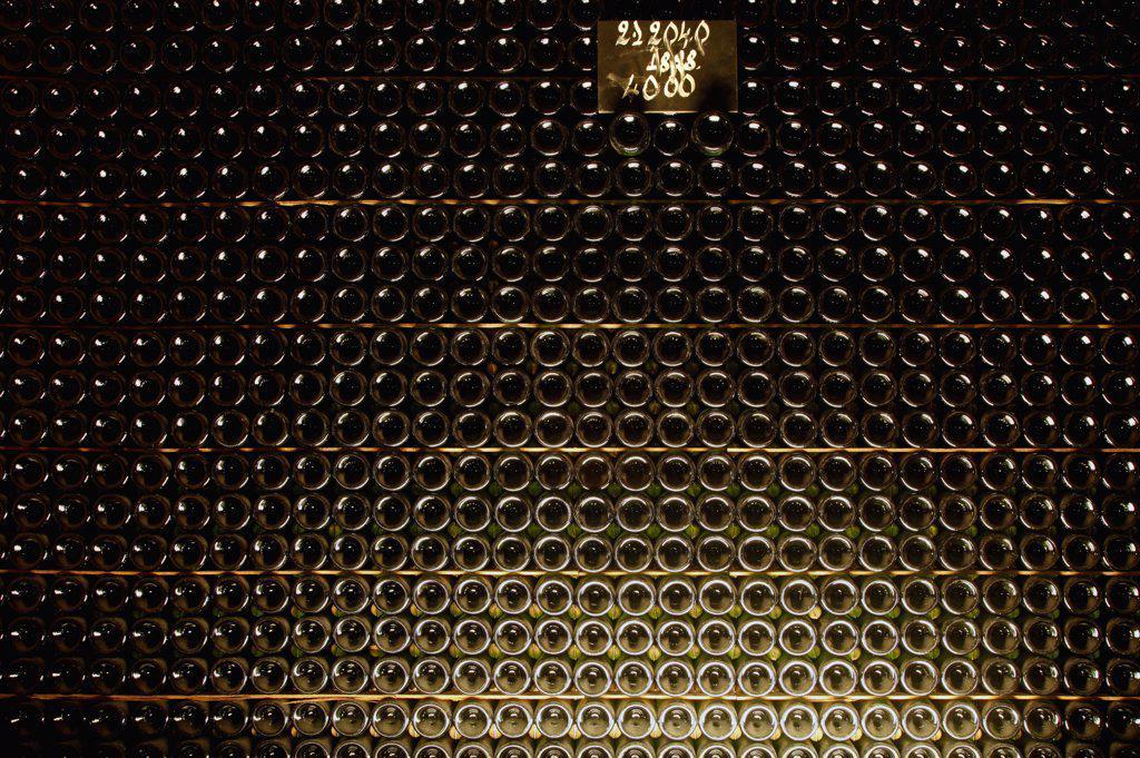 Stock Photo: 1570R-138122 Full stack of champagne bottles