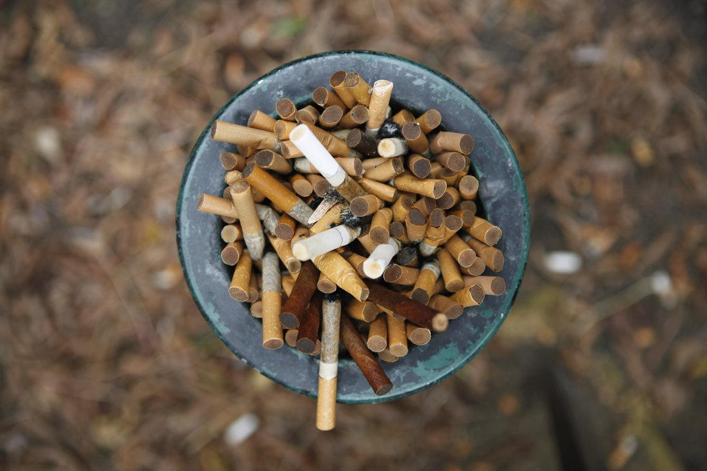 Stock Photo: 1570R-138153 Ashtray full of cigarettes outside