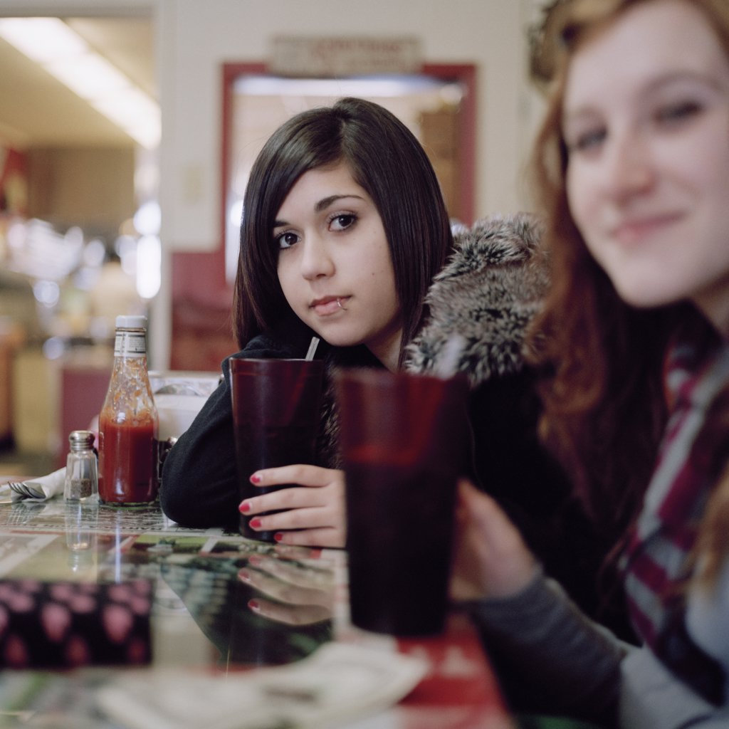 Two young women at a cafe : Stock Photo