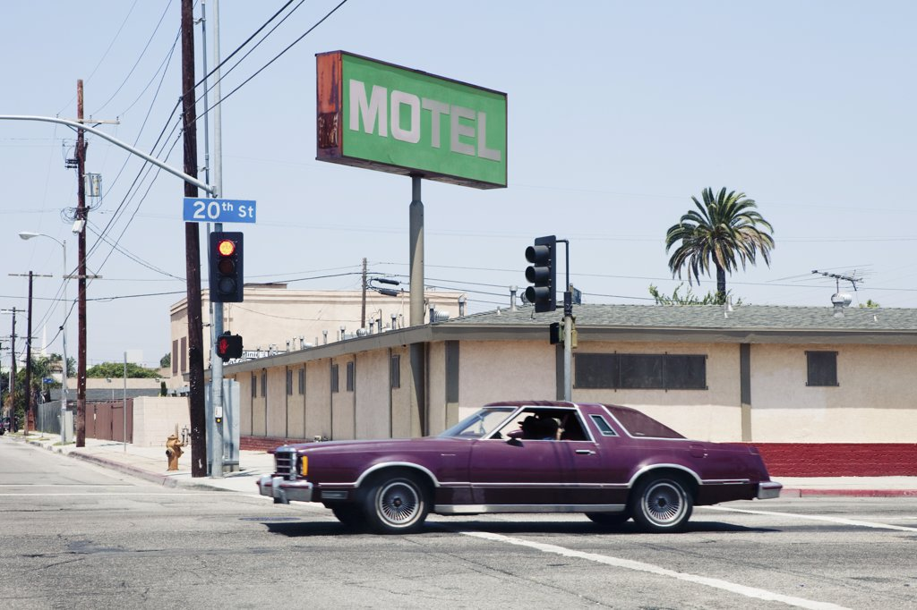 Stock Photo: 1570R-138470 Car passing motel in Los Angeles, California