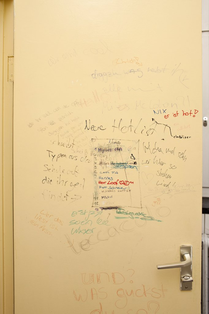 Stock Photo: 1570R-138642 Handwritten graffiti on bathroom door