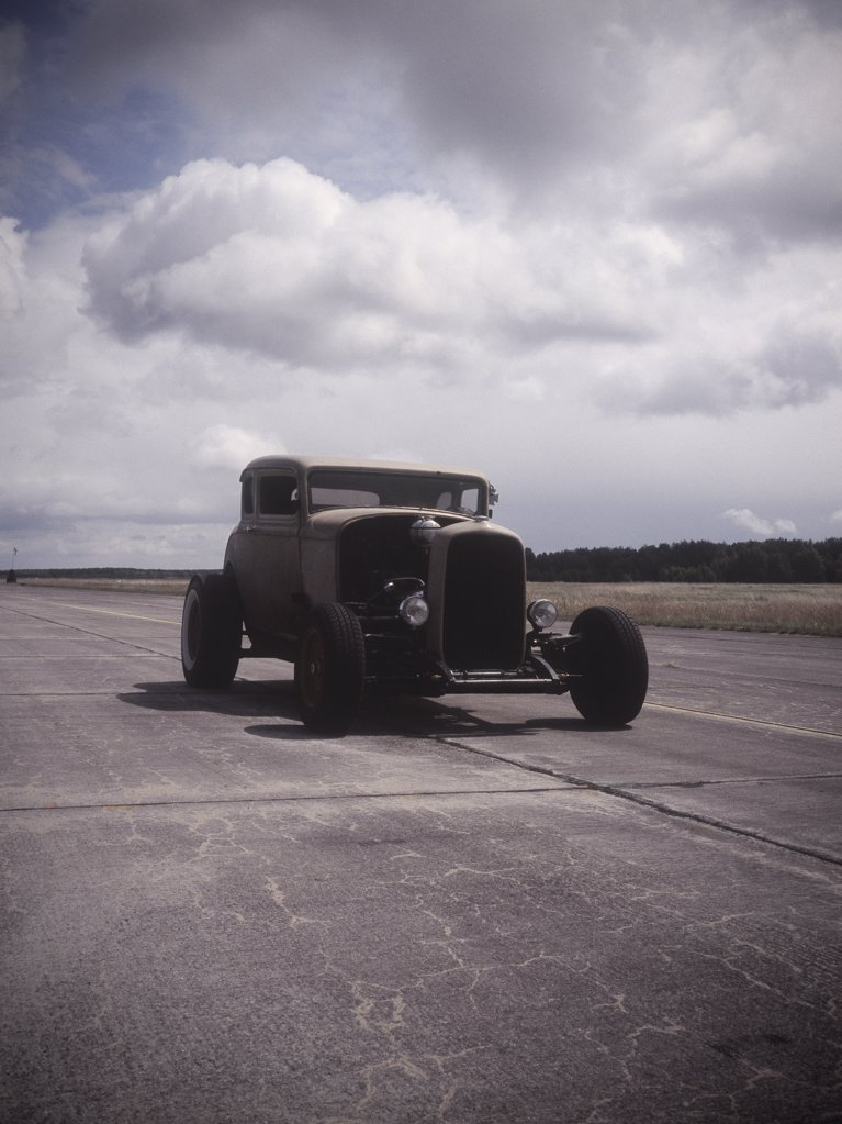 An old car on a race track : Stock Photo
