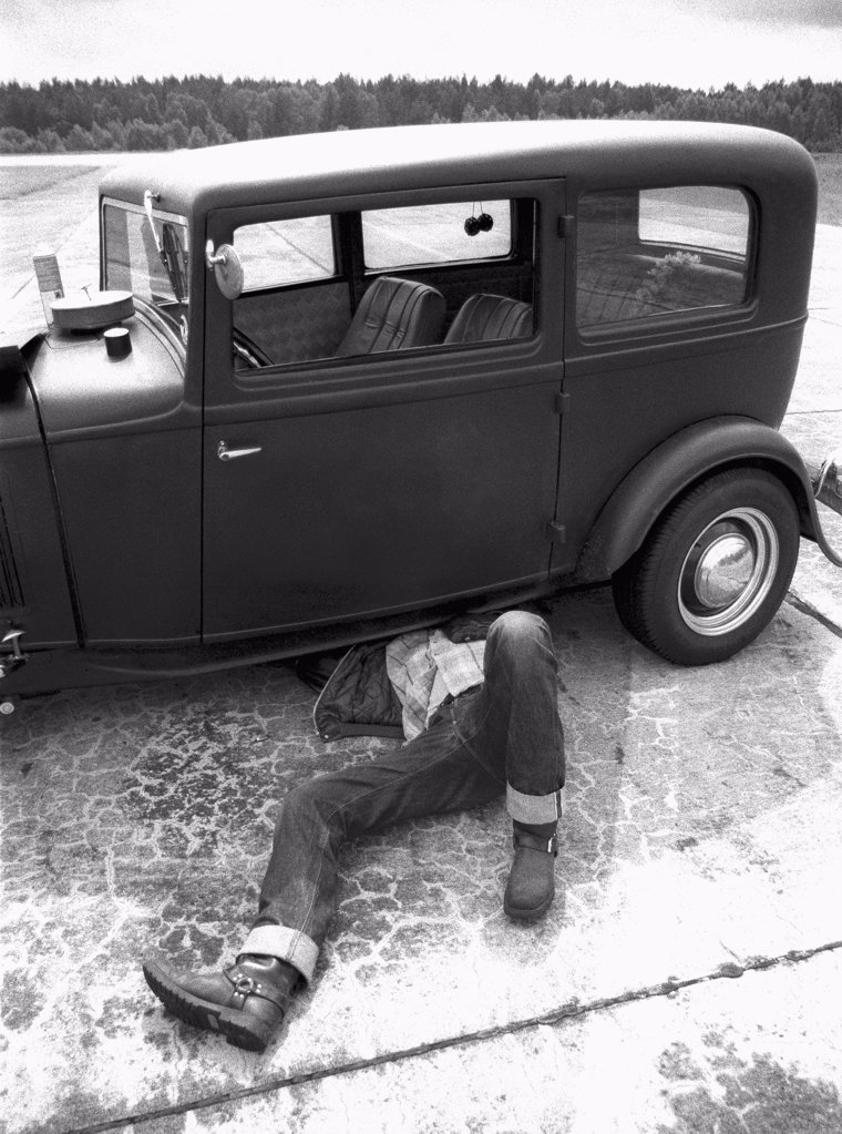Stock Photo: 1570R-138742 A man repairing an old car