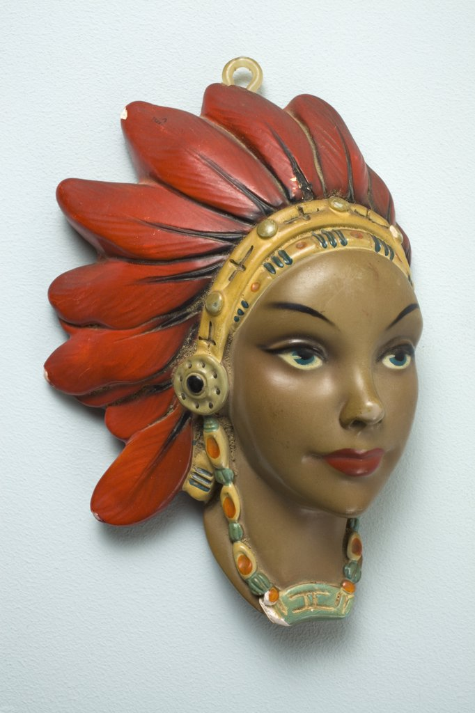 A retro female mannequin wall hanging, Native American motif : Stock Photo