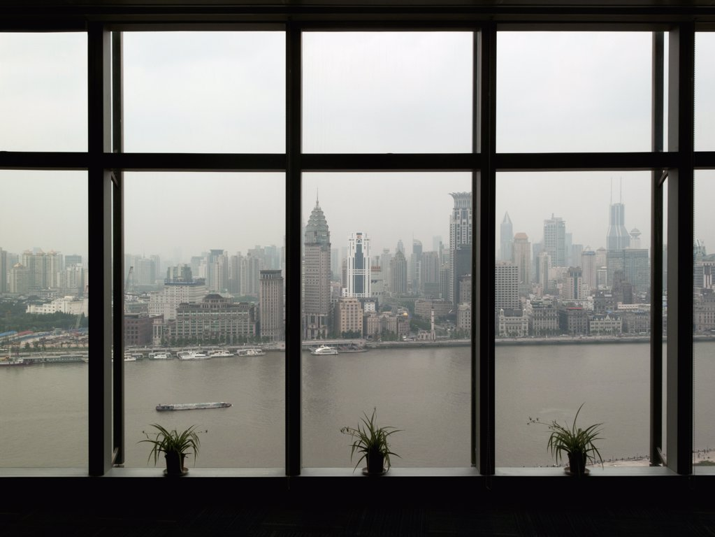 Stock Photo: 1570R-139674 Shanghai skyline seen through window