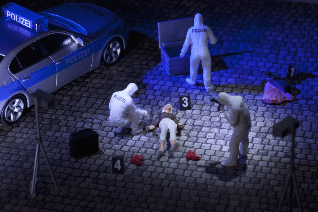 Stock Photo: 1570R-139719 A diorama of a miniature forensics team collecting evidence at a murder scene