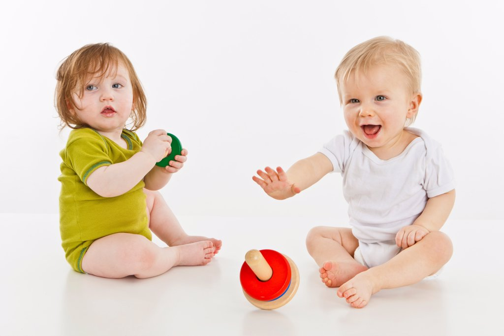 Stock Photo: 1570R-140161 Two babies playing together