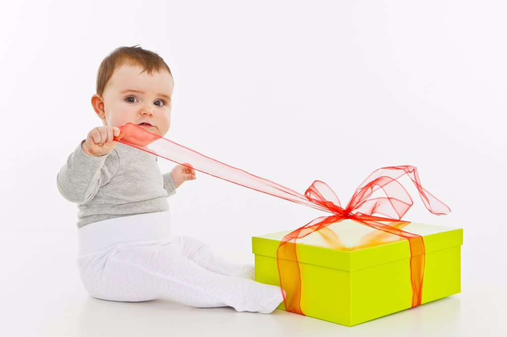 Stock Photo: 1570R-140166 A baby girl opening a present