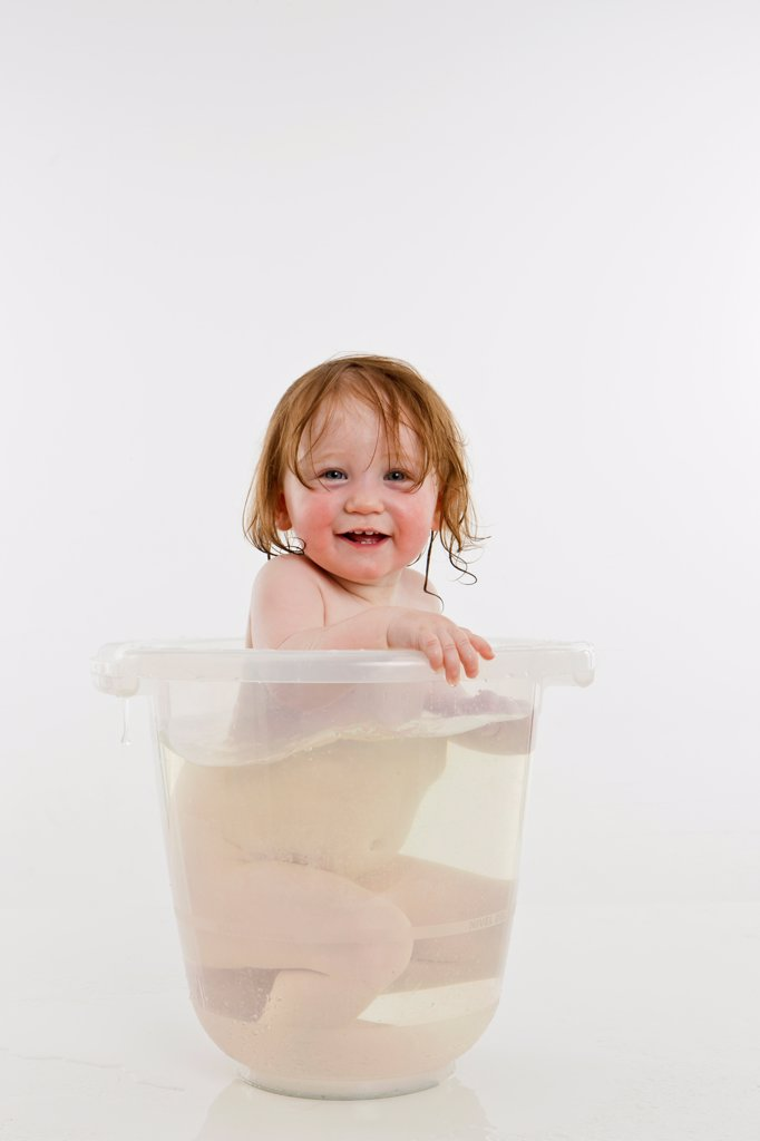 Stock Photo: 1570R-140185 A baby girl in a bucket of water