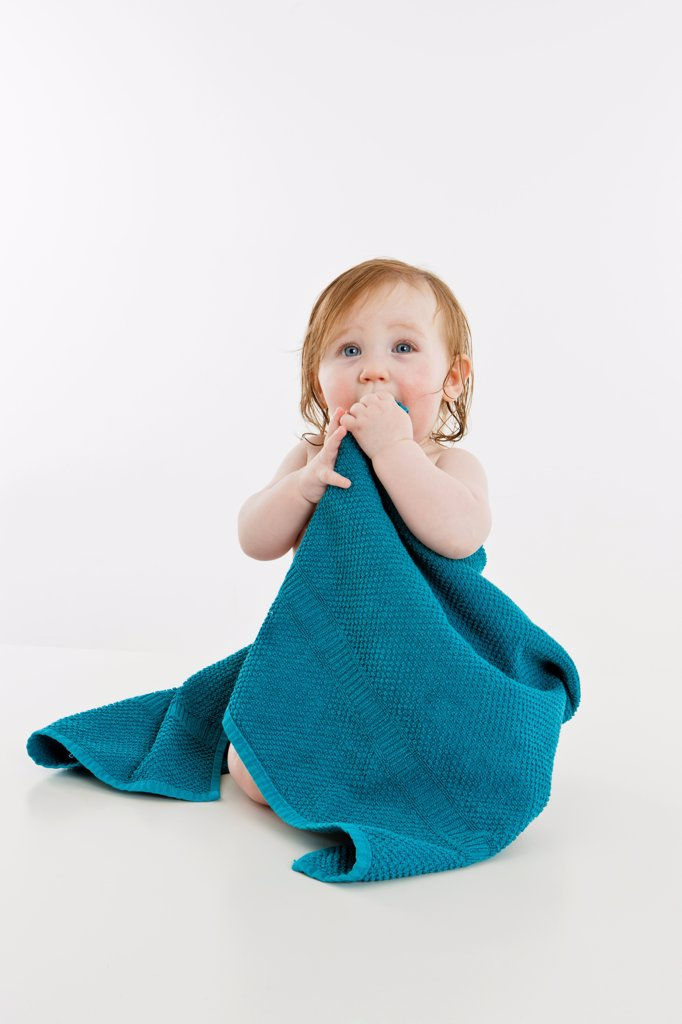 Stock Photo: 1570R-140187 A baby girl wrapped in a towel