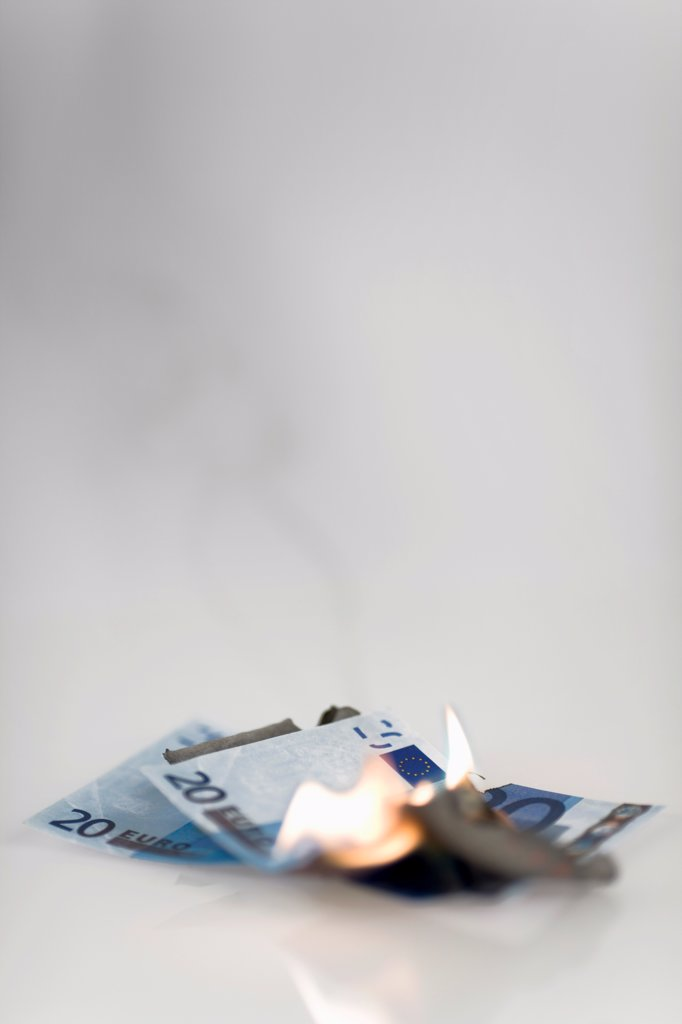 Stock Photo: 1570R-140245 Two twenty euro banknotes on fire