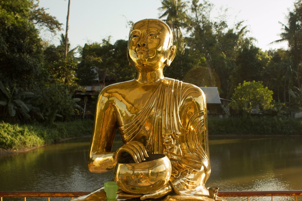 Stock Photo: 1570R-140260 A gold Buddhist statue, Yangon, Burma