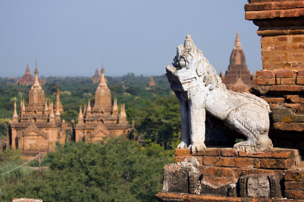 Stock Photo: 1570R-140287 A lion statue on the corner of a temple in Bagan, Burma