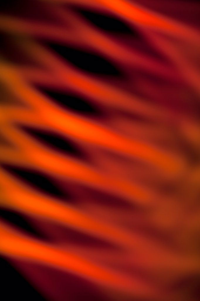 Stock Photo: 1570R-140321 Abstract pattern of crisscrossing orange and red light beams