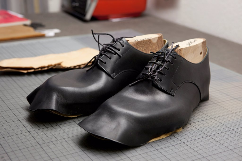 Stock Photo: 1570R-140334 A pair of shoes being made