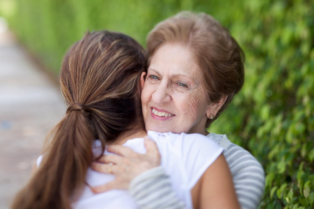 Stock Photo: 1570R-140394 A senior woman hugging a young woman