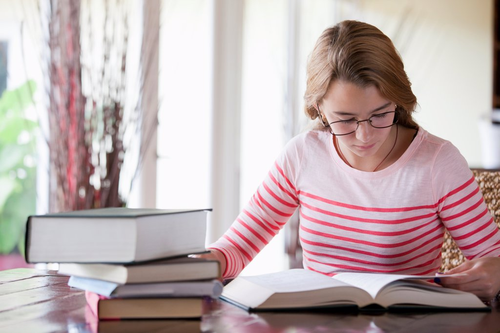 Stock Photo: 1570R-140517 Busy girl doing homework