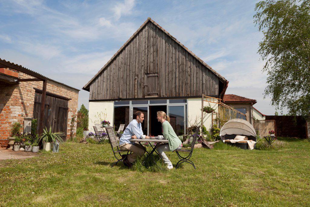 Stock Photo: 1570R-140555 A couple having breakfast in their backyard