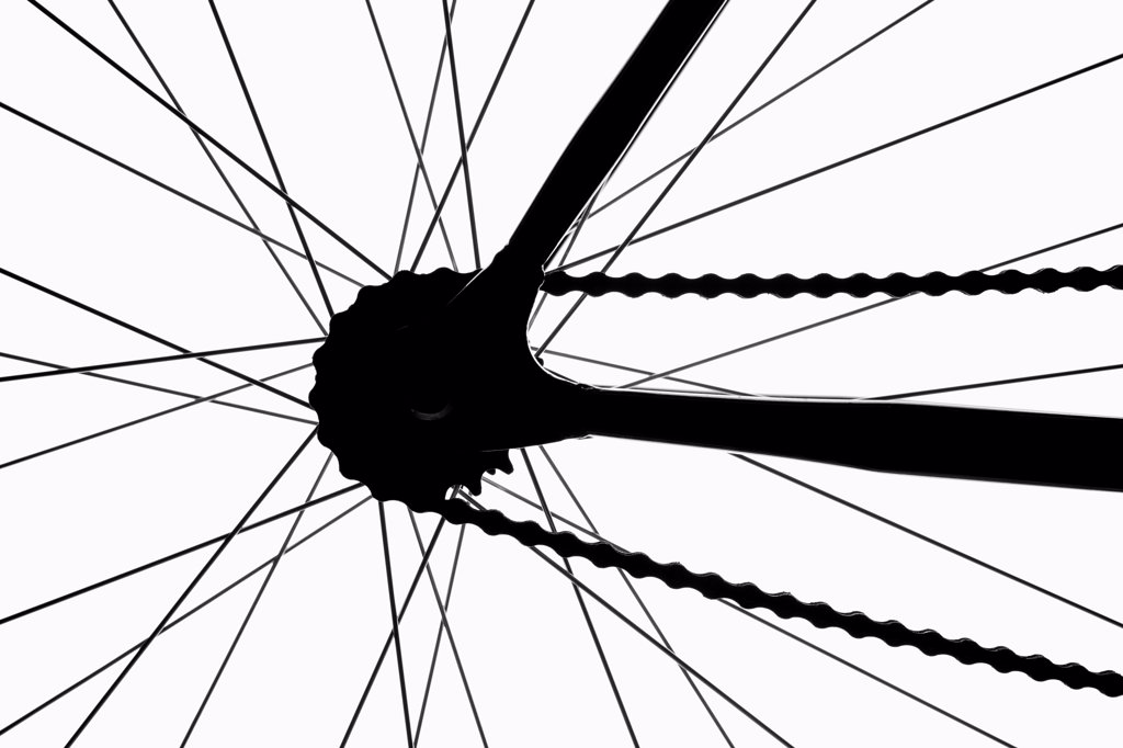 Detail of a bicycle wheel, back lit, studio shot : Stock Photo
