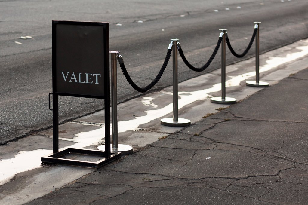 Sign and stanchions for valet parking : Stock Photo