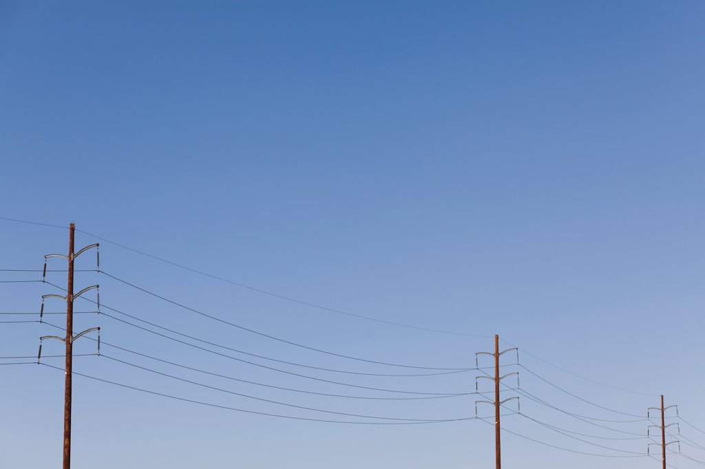 Power lines against a clear sky : Stock Photo