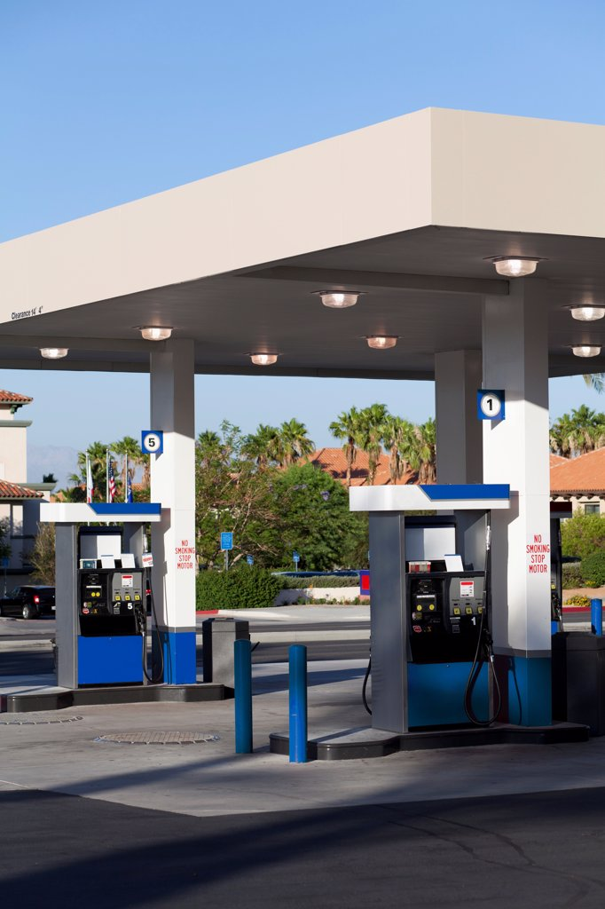 Fuel pumps at a gas station : Stock Photo