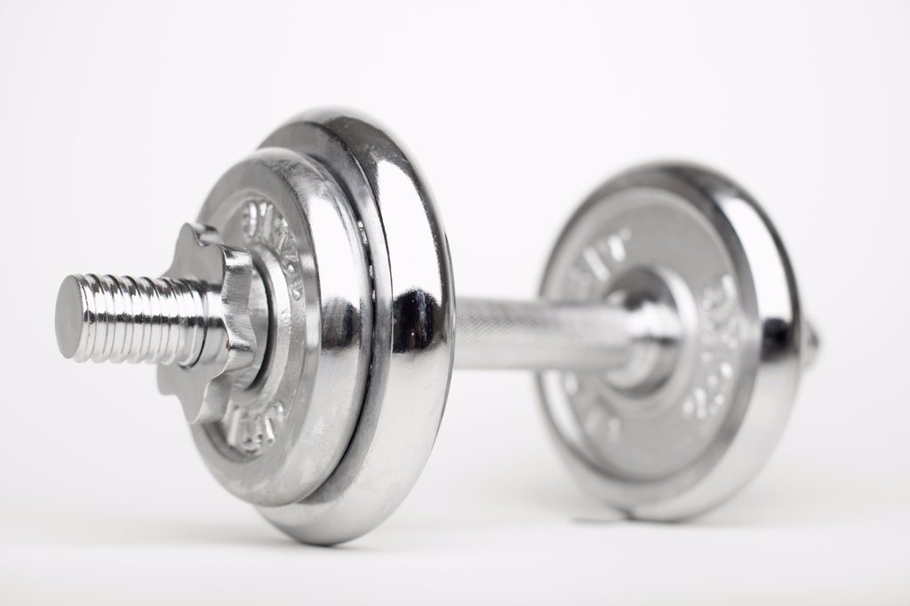 A shiny silver dumbbell : Stock Photo