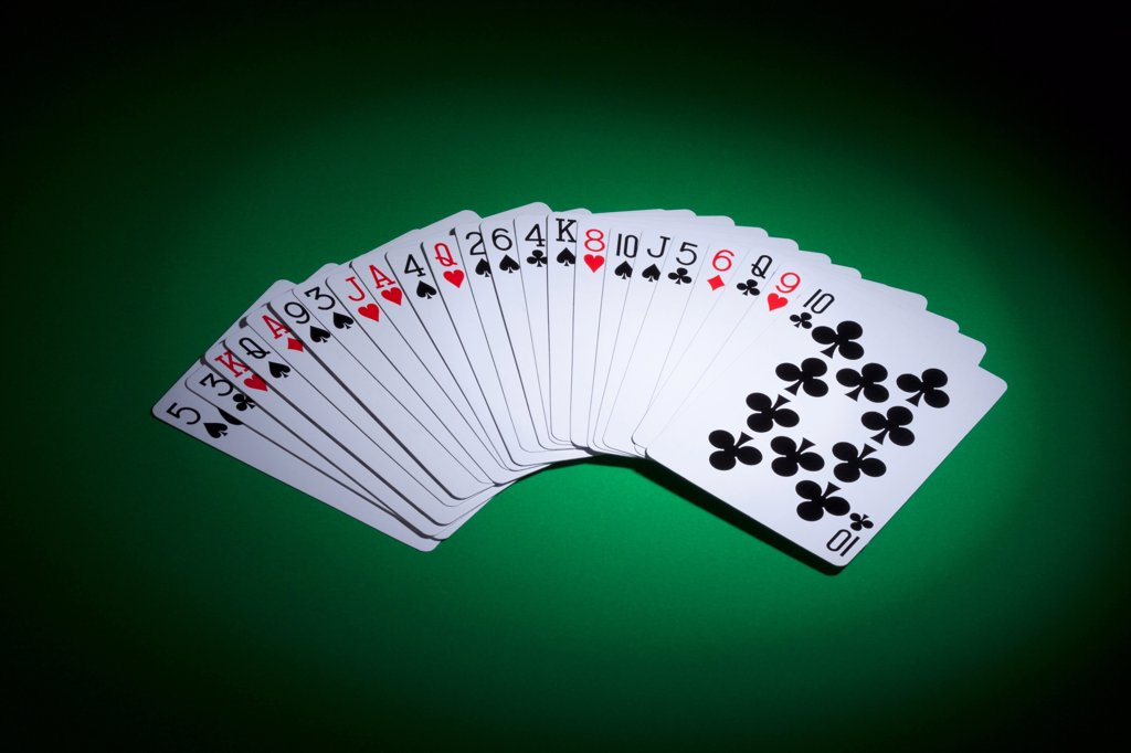 Stock Photo: 1570R-140741 Cards fanned out on a gambling table