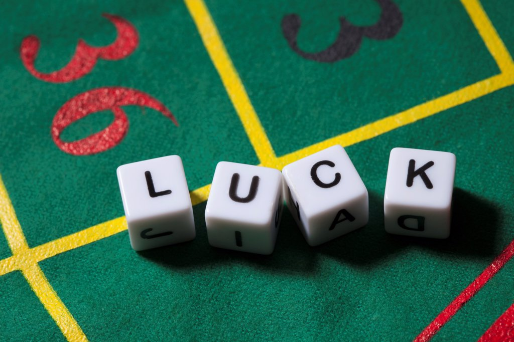 Stock Photo: 1570R-140742 Dice on a gambling table spelling the word LUCK