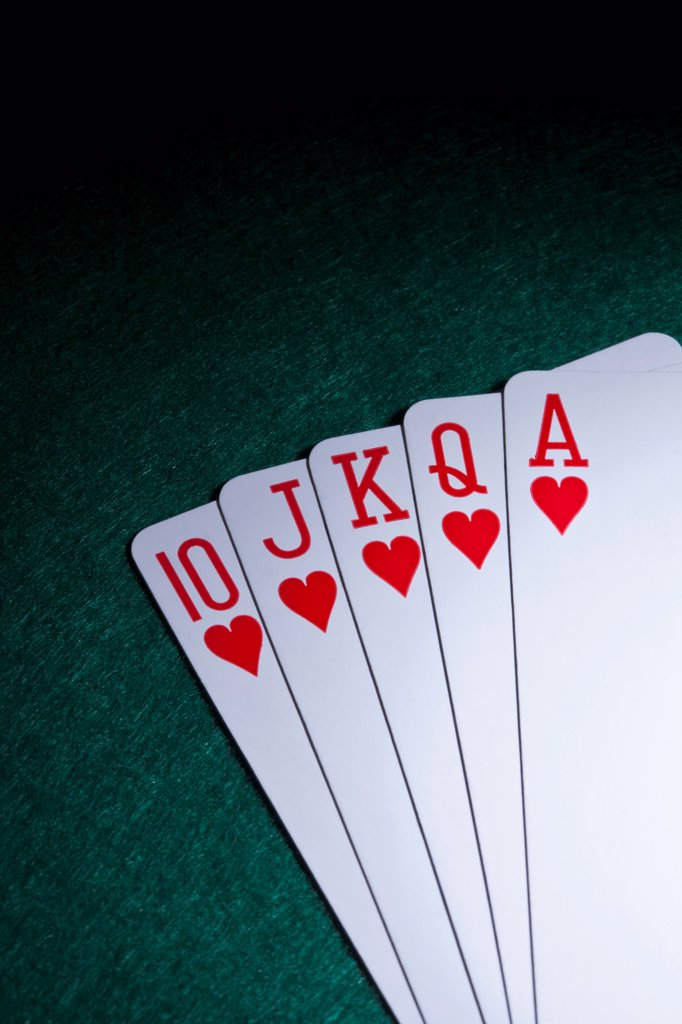 A straight flush fanned out on a table : Stock Photo