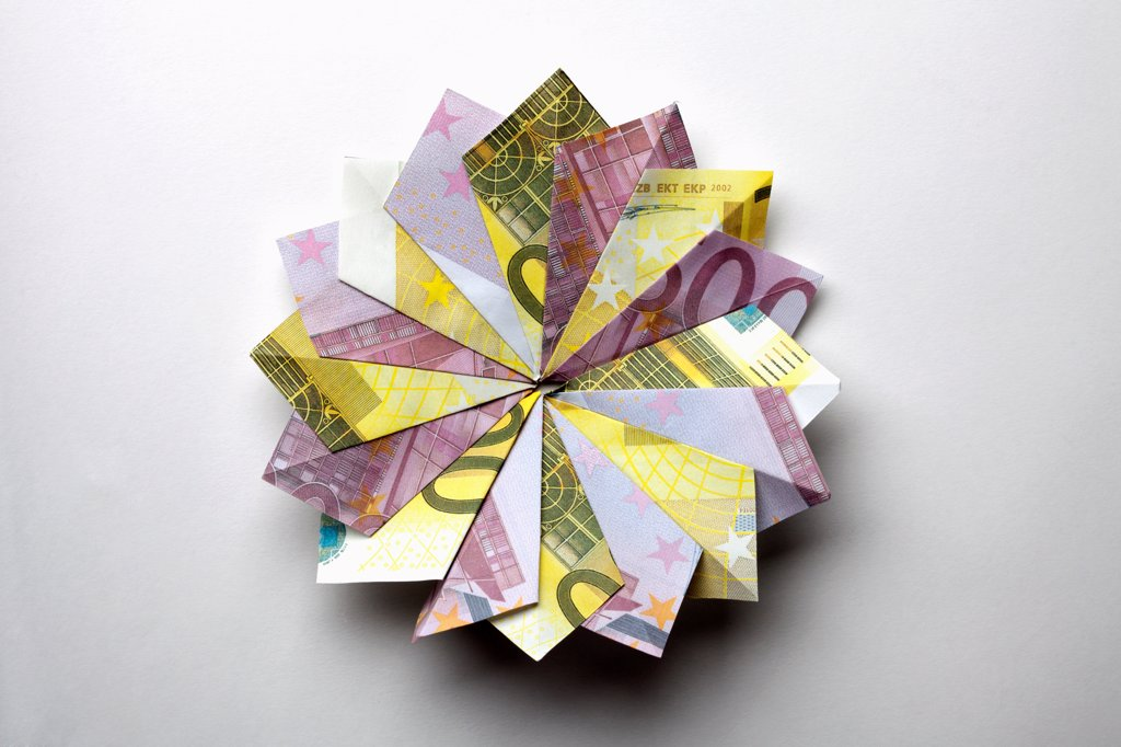 European Union currency folded into a pinwheel shape : Stock Photo
